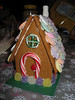 Christmas 2005 at Nanny's : This year's Christmas circle at Nanny's was preceded by gingerbread-house planning and testing, and then massive gingerbread dough manufacture, structural component and glue-icing production, and of course late-night house assembly.